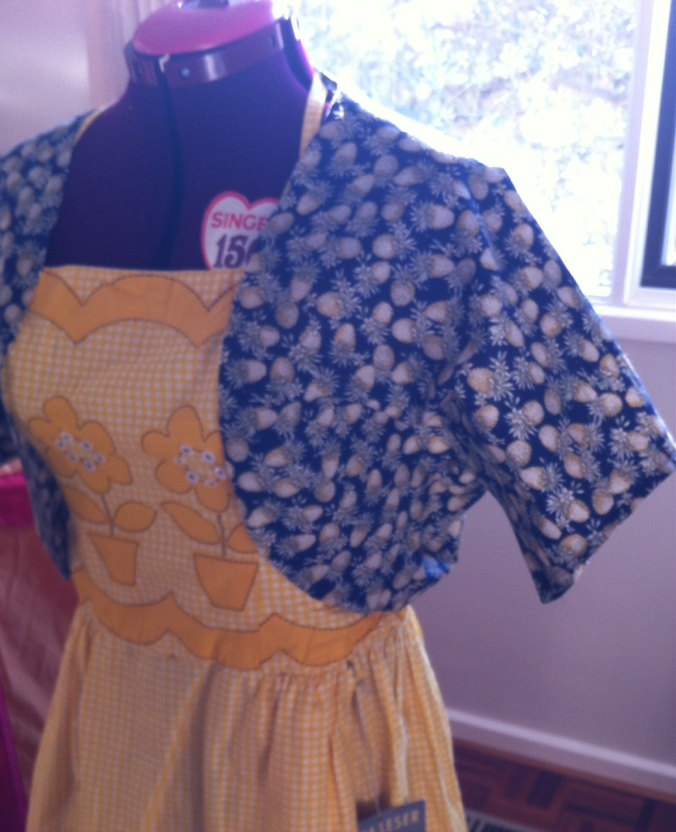Not the best photo but you get the idea- the dress beneath the bolero has just been used as a prop fopr this snap but it is a Tina Leser Original hostess dress from the 1950s that I fell in love with