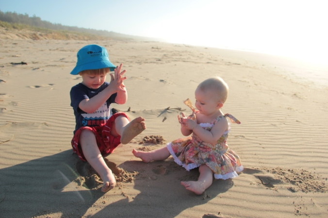 The Liberty romper... my kids enjoy early morning sunshine on Seven Mile beach...